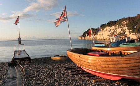 Fishing boats flying the flag on Beer beach.